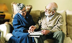 elderly couple discussing care fees